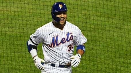 The Mets' Michael Conforto reacts after his two-run