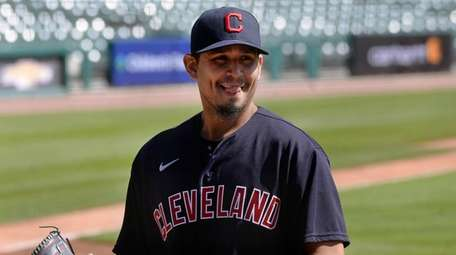 Cleveland starting pitcher Carlos Carrasco walks to the