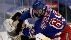 The Bruins' Jeremy Lauzon and the Rangers' Pavel