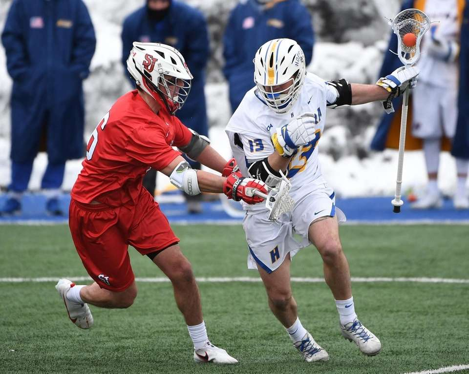 Hofstra attacker Ryan Tierney protects the ball from