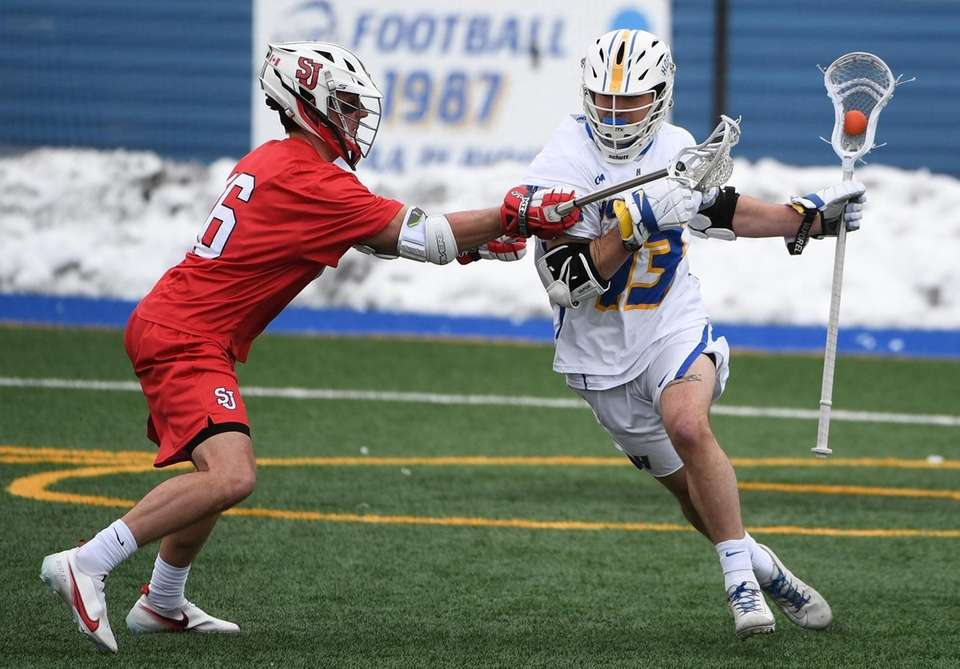 Hofstra attacker Ryan Tierney is guarded by St.