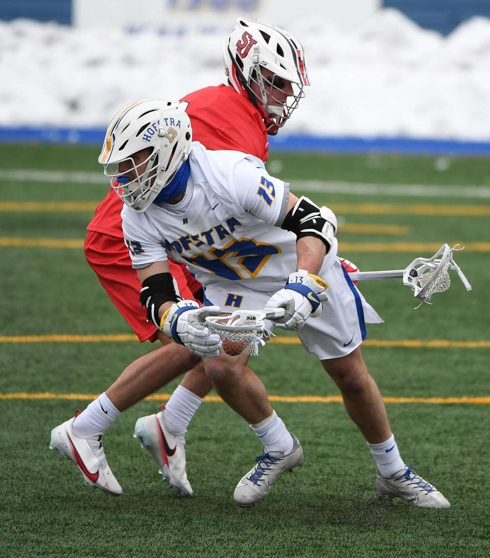 Hofstra attacker Ryan Tierney moves past his St.