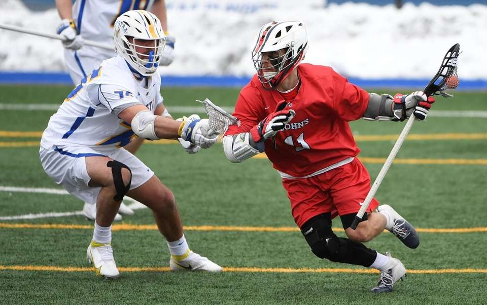St. John's midfielder/attacker Mike Madsen is guarded by