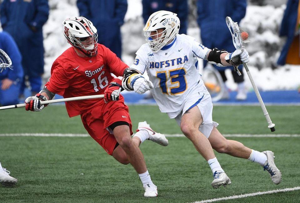 Hofstra attacker Ryan Tierney drives against St. John's