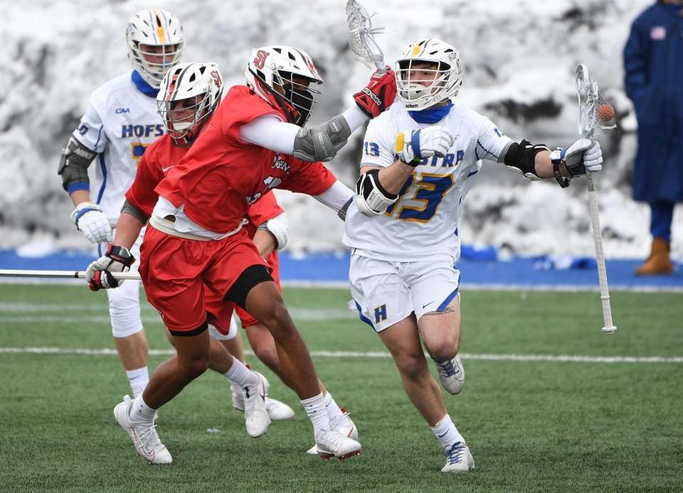 Hofstra attacker Ryan Tierney protects the ball against
