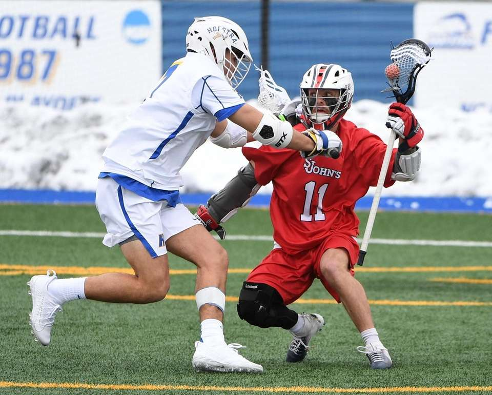 St. John's midfielder/attacker Mike Madsen is defended by
