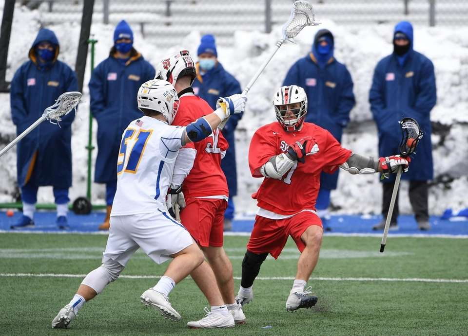 St. John's midfielder/attacker Mike Madsen protects the ball