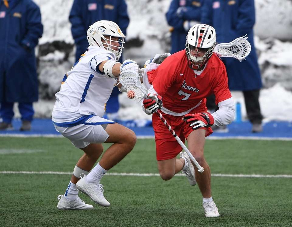St. John's midfielder/attacker Connor Kalmus is defended by