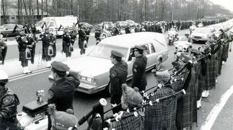 The hearse carrying the body of Suffolk County