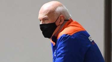 Islanders president and general manager Lou Lamoriello observes