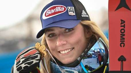 Gold medalist American Mikaela Shiffrin poses after winning