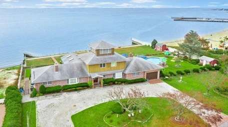 Listed for $1,559,000 in Blue Point, this four-bedroom,