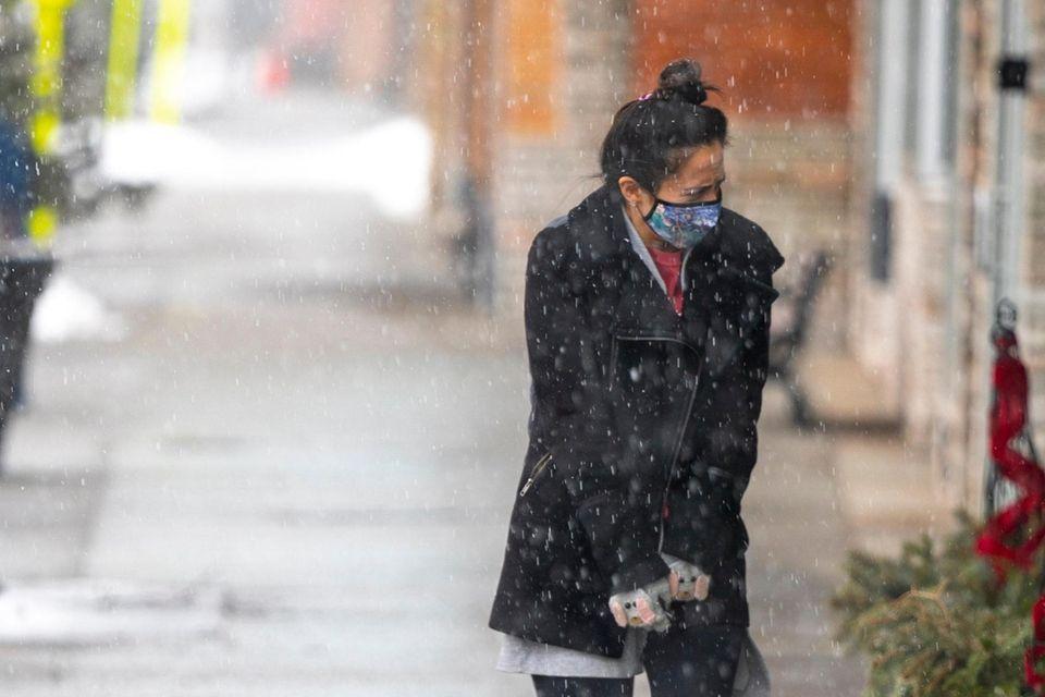 A woman takes a walk on Main Street