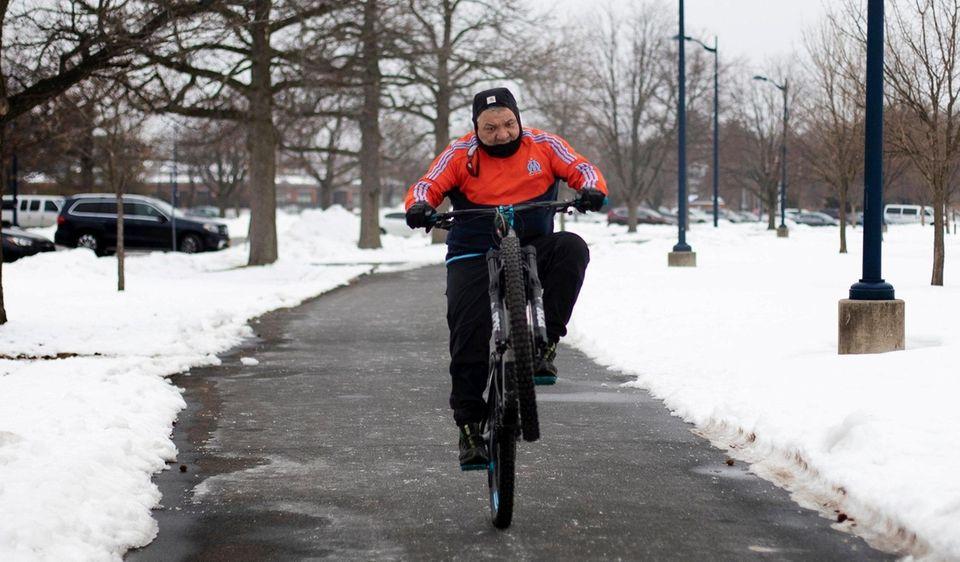 Alex Falconi,  of Freeport, rides his bike