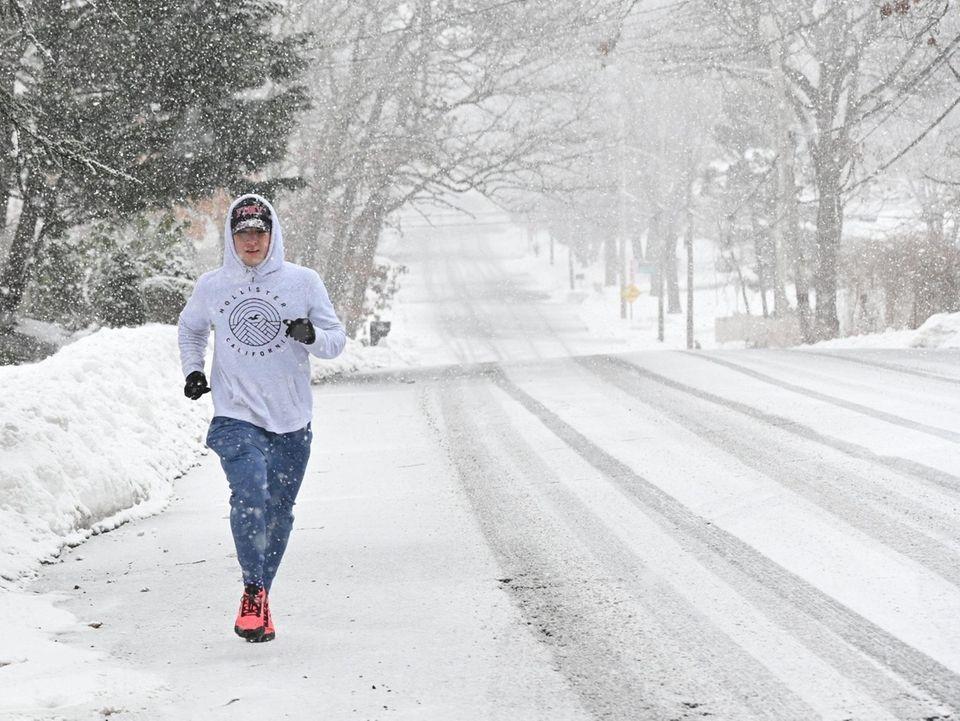 Tim Olsen of Farmingville jogs in heavy snow