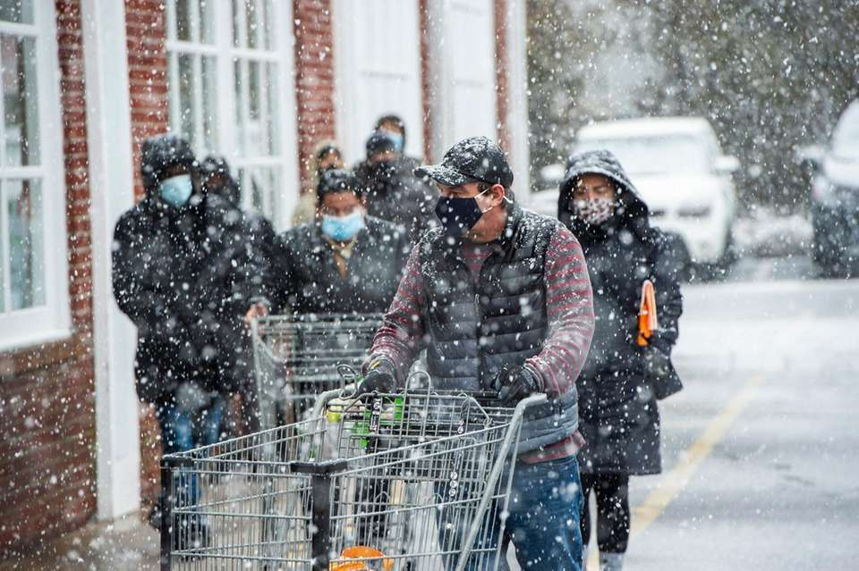 People line up for groceries outside Stop &