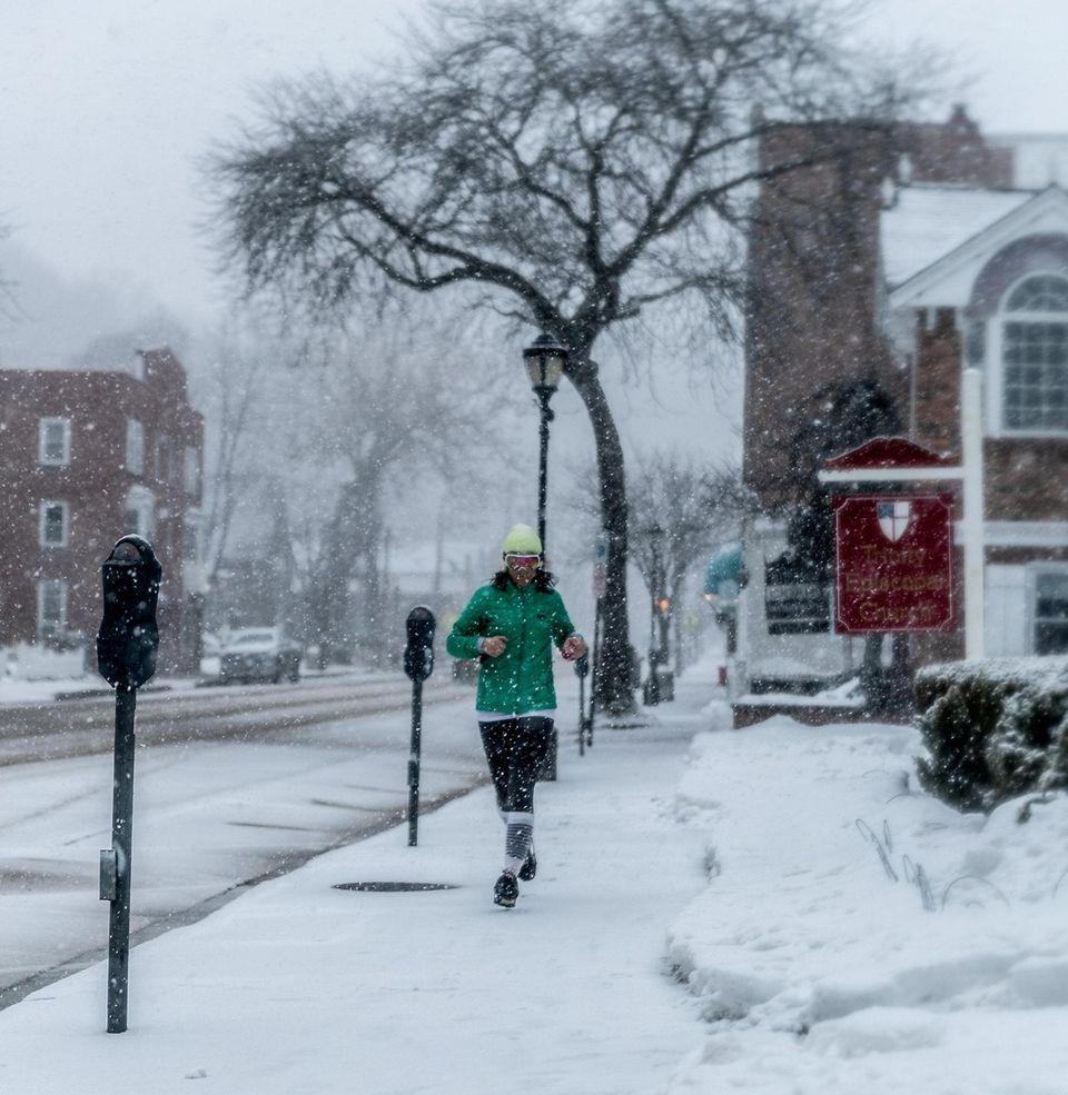 Kacey O'Brien goes for a snowy run in