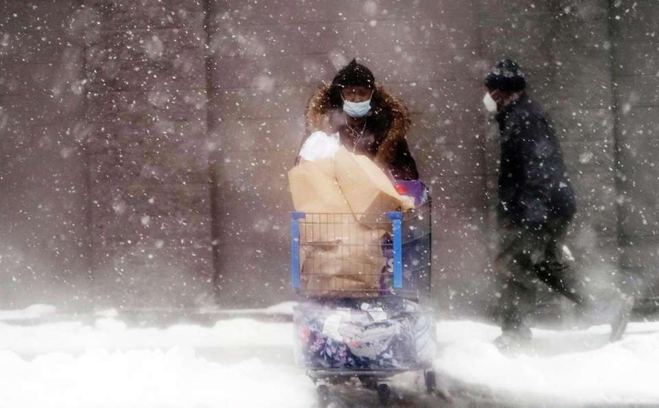 Shoppers in the snow, February 7, 2021 in