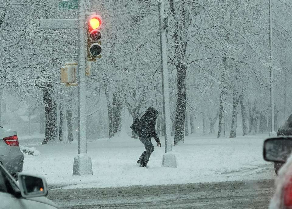 A pedestrian in the snow on Sunrise Highway