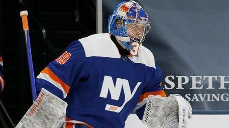 Ilya Sorokin #30 of the Islanders warms up