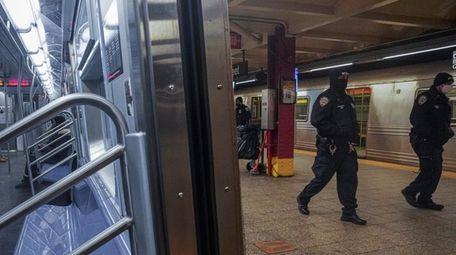 Police patrol the A line subway train bound
