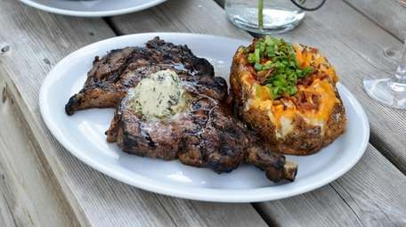 The prime cowboy ribeye steak with a loaded