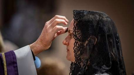 The traditional smudging of ashes for Ash Wednesday
