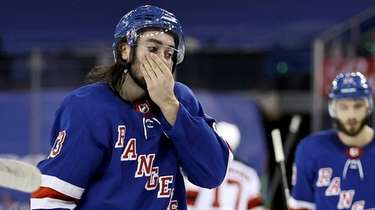 The Rangers' Mika Zibanejad and teammates react to