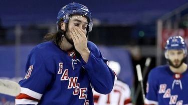 The Rangers' Mika Zibanejad and teammates react to