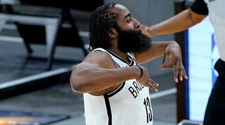 Nets guard James Harden celebrates a three-pointer against
