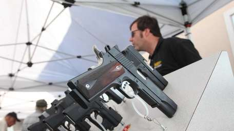 Frank E. Harris from Kahr Arms displays semi-automatic