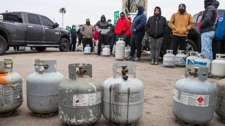 People line up to fill their empty propane