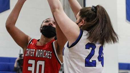 Emily Psarro of Center Moriches puts the ball