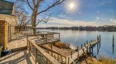 This renovated waterfront home with detached guest apartment