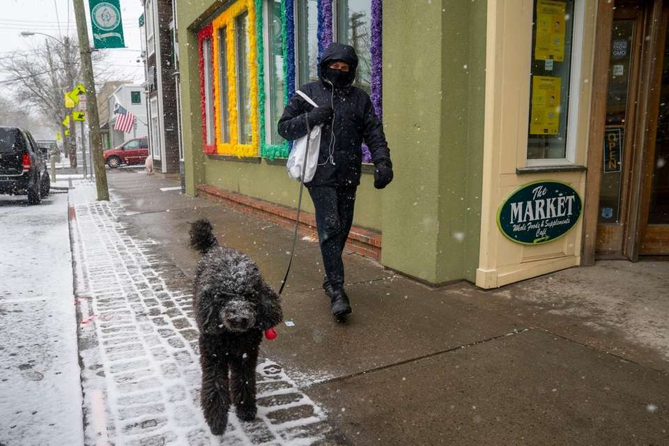 Snow falls on Front Street in Greenport on