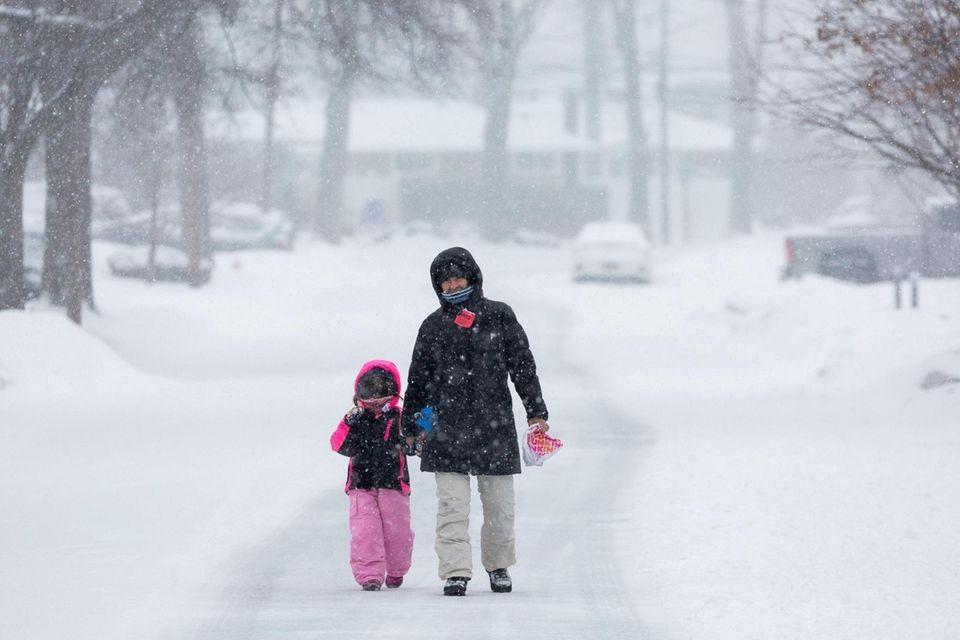Diana Weiner and her daughter, Lilliana, 4, walk