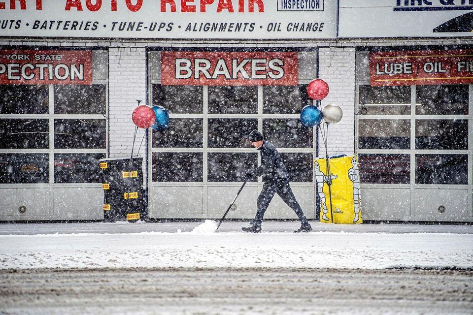 A man shovels snow in Massapequa, Thursday Feb.