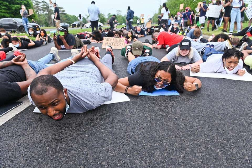 Protestors chant on the ground while walking down