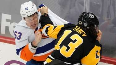The Penguins' Brandon Tanev and the Islanders' Casey