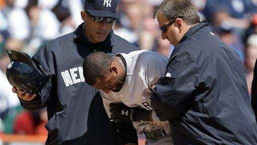 Eduardo Nunez grimaces while helped to the dugout