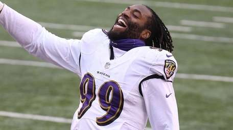 Matthew Judon of the Ravens celebrates after the