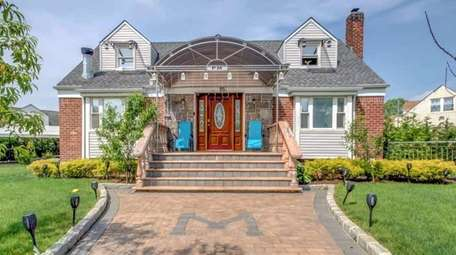 Priced at $1,450,000, this six-bedroom, four-bathroom Cape sits