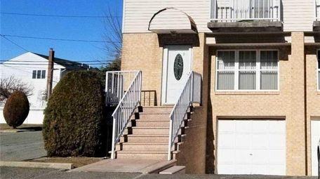 Priced at $439,000, this three-bedroom, 3½-bathroom condominium on