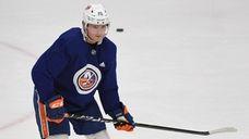 Islanders left wing Kieffer Bellows skates during training