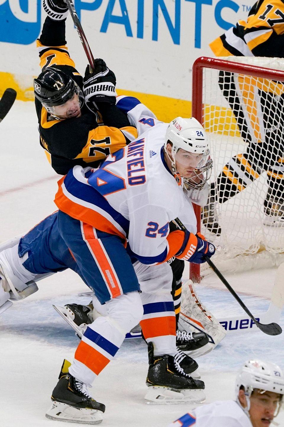 Pittsburgh Penguins' Evgeni Malkin (71) tumbles over New