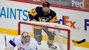 Pittsburgh Penguins' Sidney Crosby skates behind the net