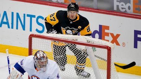 Pittsburgh Penguins' Sidney Crosby skates behind the net