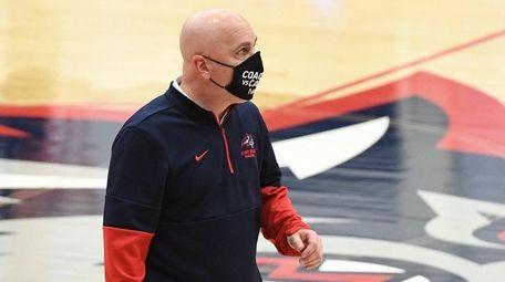Stony Brook head coach Geno Ford looks on