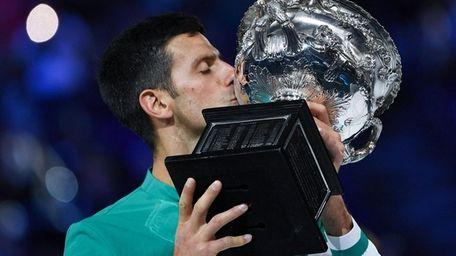 Serbia's Novak Djokovic kisses the Norman Brookes Challenge