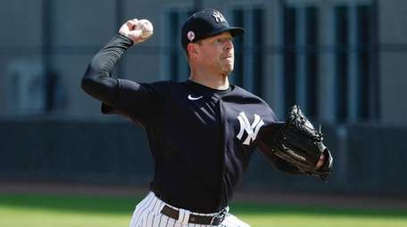Yankees pitcher Corey Kluber pitches during spring training